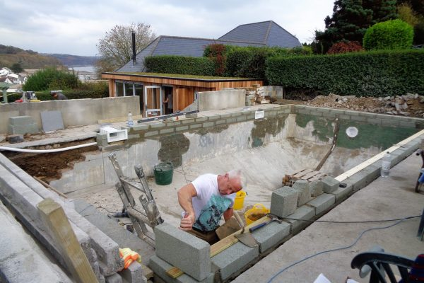 man refurbishing pool over 45 years old
