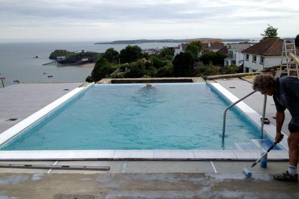 Pool refurbishment and renovation - Reinforced Concrete/tile infinity edge pool